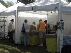 Folks perusing my jewelry at. The show